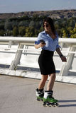 Woman skating backwards. In a city, Spain Stock Photography