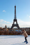 Woman are skating, Eiffel Tower in winter Royalty Free Stock Photography