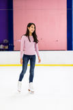 Woman skating on ice rink Stock Photo