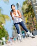 Woman skating outdoors Royalty Free Stock Image