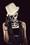 Woman with skeleton face art. Over black background stock image