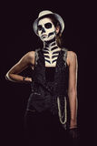Woman with skeleton face art smoking stock photo
