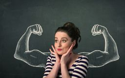 Woman with sketched strong and muscled arms Stock Photo