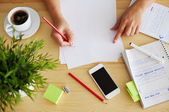 Woman sketching design, top view. Graphic designer sketching web design in office Royalty Free Stock Image