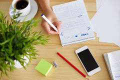 Woman sketching design, top view. Woman sketching on paper web design in office Stock Photos