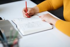 Woman sketching new design for a website stock photos