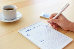 Woman sketching web design Royalty Free Stock Image