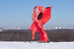 Woman on ski with flag Stock Photo