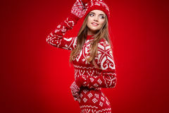 Woman with ski goggles isolated on red Royalty Free Stock Image