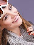 Woman in ski googles warm winter clothing portrait Stock Image
