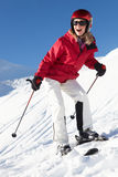 Woman On Ski Holiday In Mountains Royalty Free Stock Images