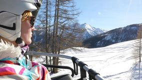 Ski lift female portrait stock video