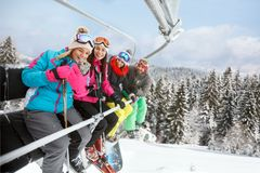 Woman in ski lift taking selfie with friends royalty free stock photos
