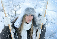 Woman with ski over winter background Stock Image