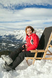 Woman on ski resort in sunny winter day Stock Images