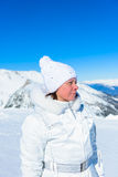Woman in ski suit on a background of mountains Royalty Free Stock Photos
