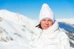 Woman in ski suit on a background of mountains Royalty Free Stock Photo