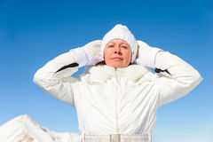 Woman in snowy mountains Royalty Free Stock Photo