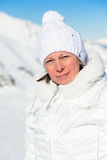 Woman in ski suit on a background of mountains Stock Photos