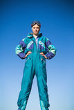 Woman in ski suit with hands on hips Royalty Free Stock Photos