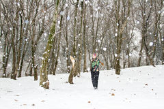 Woman in ski suit ran  in snowy winter Stock Photos