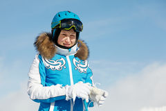 Woman in ski suit stands on background of sky Royalty Free Stock Images