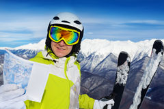 Woman with ski track map on the mountain Royalty Free Stock Photo