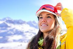 Woman in ski wear contemplating view. Royalty Free Stock Image