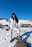 Woman in Ski Wear at Snow Looking at the Camera Royalty Free Stock Photo