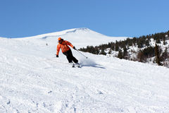 Woman skier. Slide down on hill Royalty Free Stock Photos