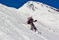 Woman skier in the deep snow Royalty Free Stock Photography