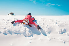 Woman skier enjoying the snow sunbathing and smiling Royalty Free Stock Image