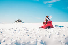 Woman skier enjoying the snow sunbathing Royalty Free Stock Images