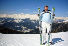 Woman skier enjoying sun Stock Image