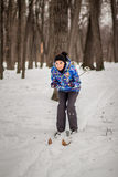 Woman skier in forest Stock Image
