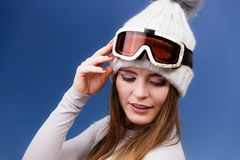 Skier girl wearing warm clothes ski googles portrait. Woman skier girl wearing warm clothing ski googles portrait. Winter sport activity. Beautiful sportswoman stock photography