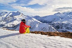 Free Woman Skier Looking At The Mountain Peaks In The French Alps, On Les Sybelles Ski Domain, Above Saint-Jean-d`Arves Village, France Royalty Free Stock Image - 168880266