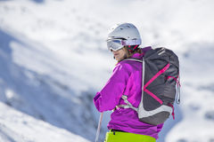 Woman skier. Looking at the mountains royalty free stock image