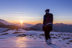 Woman skier. Looking at the sunset royalty free stock image