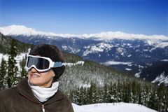 Woman skier in mountains. Royalty Free Stock Photo
