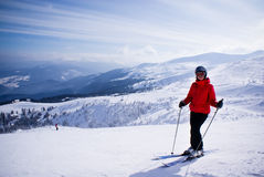 Woman skier in the mountains Royalty Free Stock Image