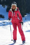 Woman skier in red outfit Royalty Free Stock Images