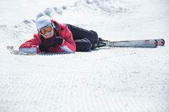 Woman skier resting at snowy ski piste Royalty Free Stock Images