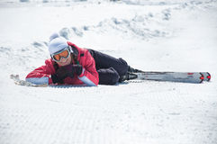 Woman skier resting at snowy ski piste Royalty Free Stock Photography