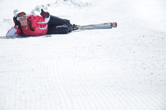 Woman skier resting at snowy ski piste Stock Photo
