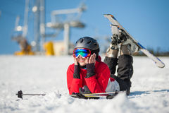 Woman skier with ski at winer resort in sunny day Stock Image