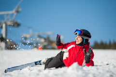 Woman skier with ski at winer resort in sunny day stock photography