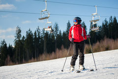 Woman skier with ski at winer resort in sunny day Stock Images