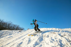 Woman skier skiing downhill in the winter forest Royalty Free Stock Photo