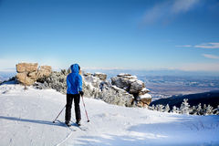 Woman skier on a slope in the winter mountain Royalty Free Stock Image